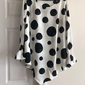 White with black polka dot pointed hem blouse